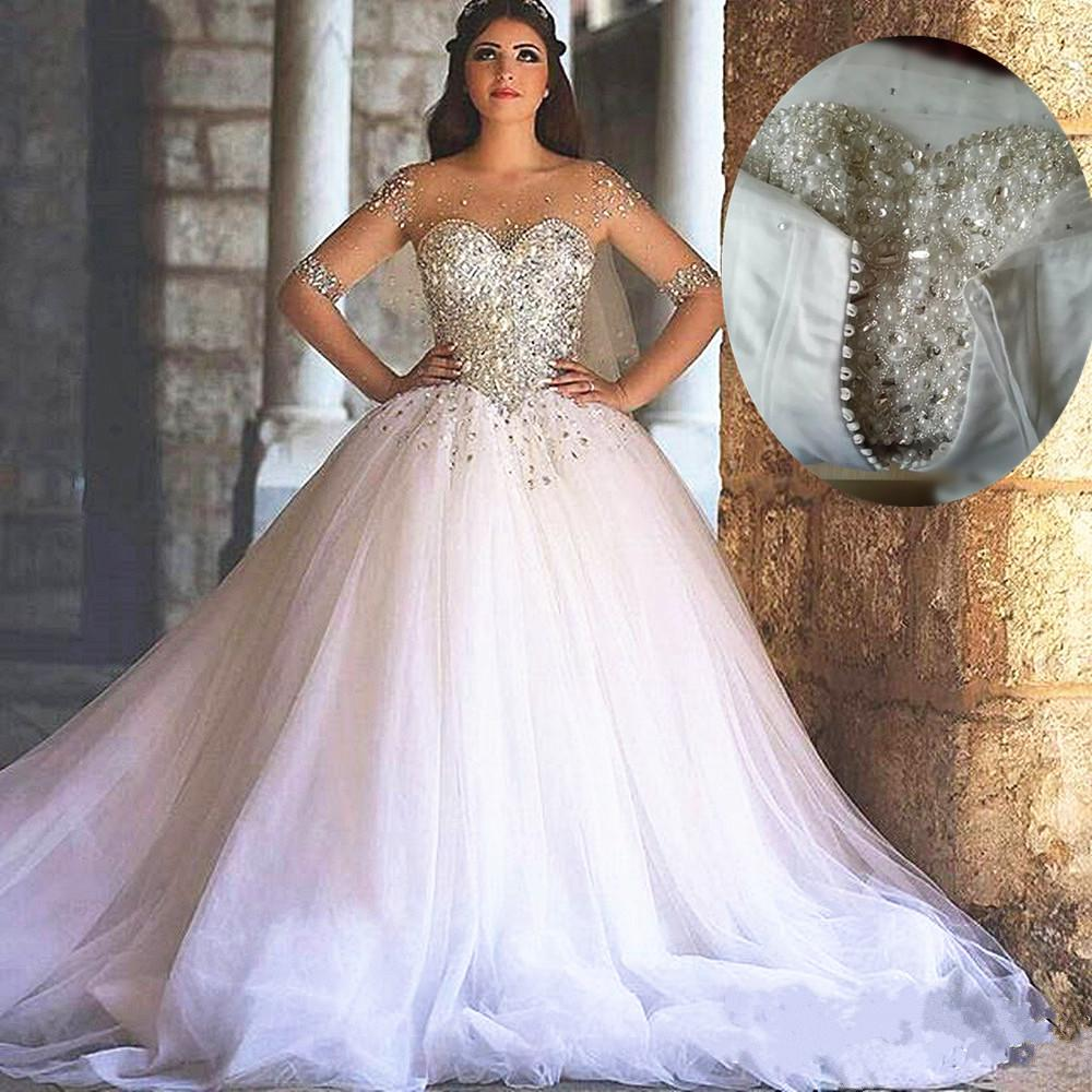 2017 Arabic Wedding Gowns Crystal Beads Ball Gown Illusion
