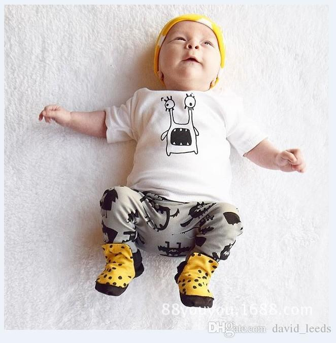 2016 여름 새로운 아기 소년 소녀 의류 세트 아이 만화 짧은 소매 티셔츠 탑 + 인쇄 바지 2 개 세트 어린이 의상 정장 0-4 년