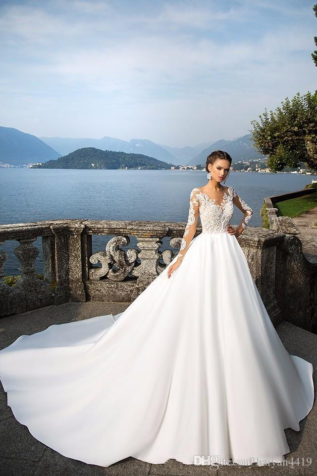 2017 New Milla Nova A Line Wedding Dresses Illusion Long Sleeves Lace Appliques Beaded Sheer Back Court Train Plus Size Formal Bridal Gowns
