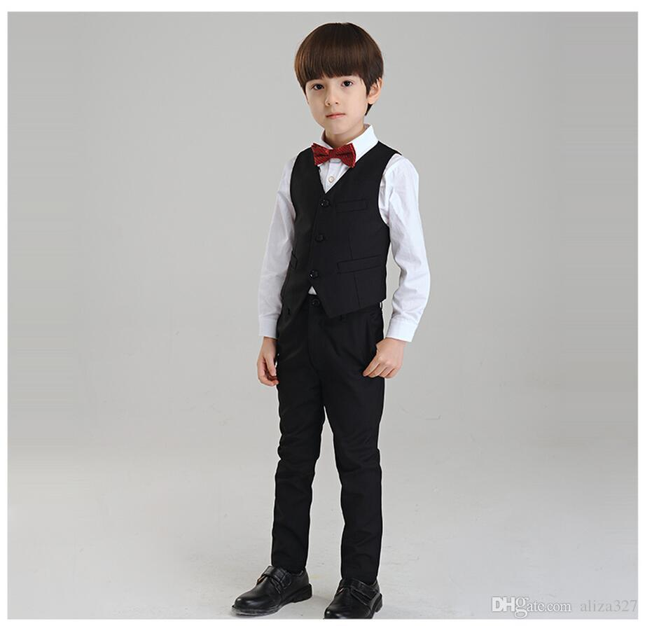 The latest styles let him look sharp when worn with a smart pair of boys' formal shoes. Some sets feature a matching vest as well as a tie with a clip-on design. Some sets feature a matching vest as well as a tie with a clip-on design.