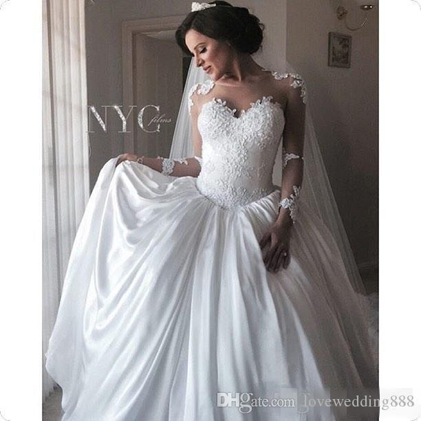 2019 Sheer Long Sleeves Wedding Dresses Lace Appliques Illusion Zipper Back Ivory Princess Puffy Bridal Gowns Aso Ebi Style A Line Dress