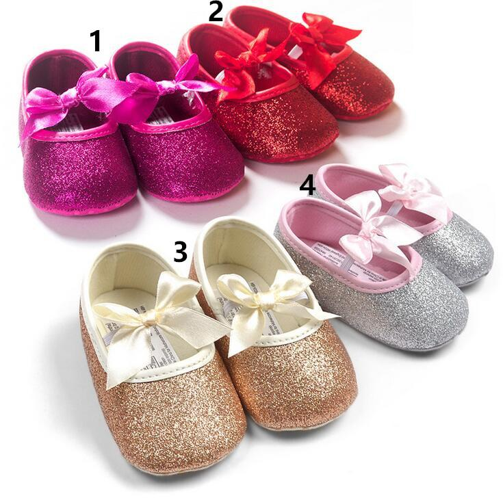 Bebê primeiros caminhantes meninas infantis novo bebê primeiros caminhantes brilhantes fitas bowknot macio sola moda bebê sapatos de algodão 0-24m crianças crianças