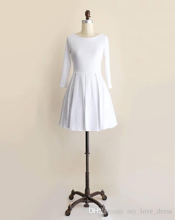 Robe courte blanche à manches longues Robe vintage inspirée et évasée à dos Bow Ponte Petite robe de soirée en tricot au dessus du genou