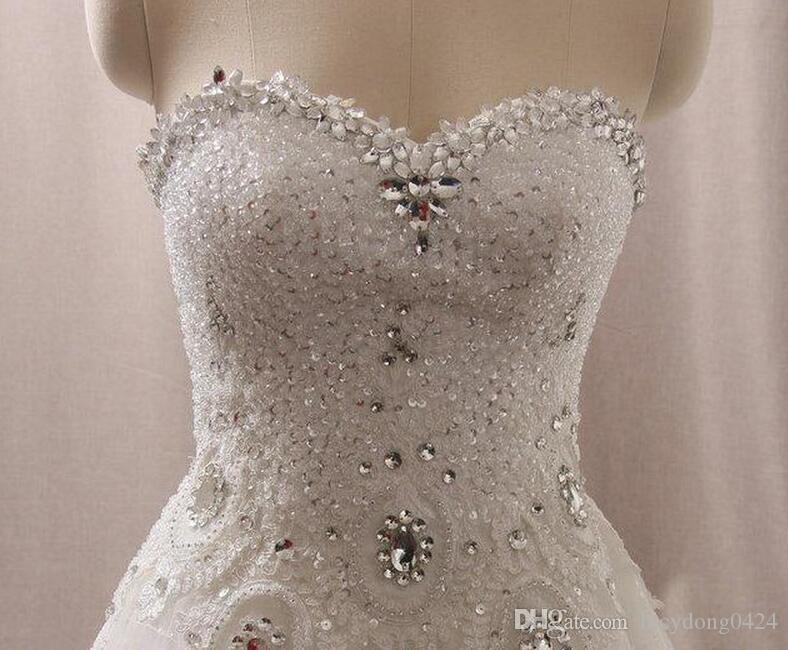 Neueste Luxus Brautkleider Schatz Swarovski Kristalle Perlen Backless Ball Kleid Kapelle Zug Bling Customed Elfenbein Brautkleider