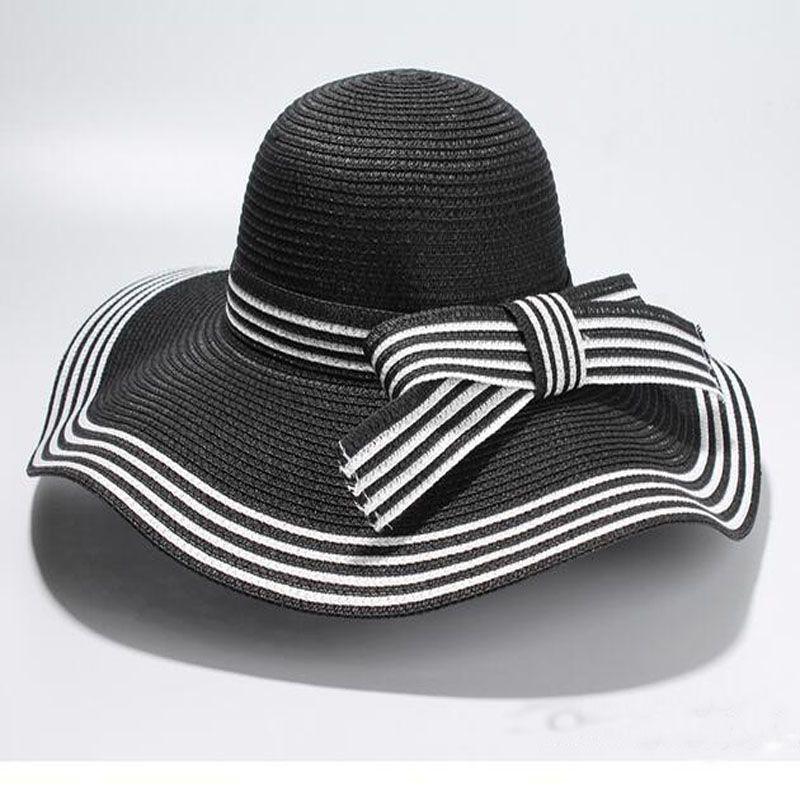 09b672b06df16 Wholesale New Summer Elegant Bowknot Sun Hat Black White Striped Straw Hat  Beach Vacation Shade Folded Large Along Hat Sun Hats Sun Hat From Heheda1