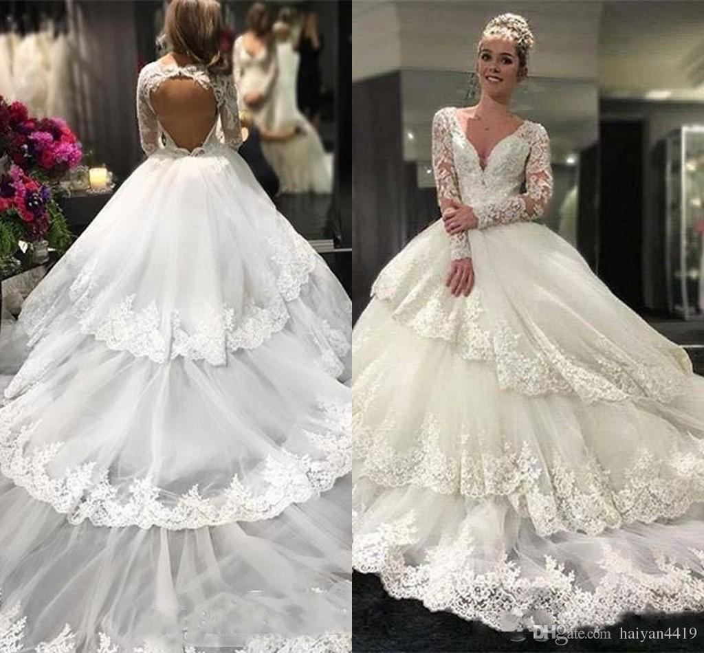 f65dd56a3e4 Discount 2017 Charming Wedding Dresses Deep V Neck Lace Appliques Beaded  Sheer Long Sleeves Open Back Tiered Ruffles Tulle Plus Size Bridal Gowns  Empire ...