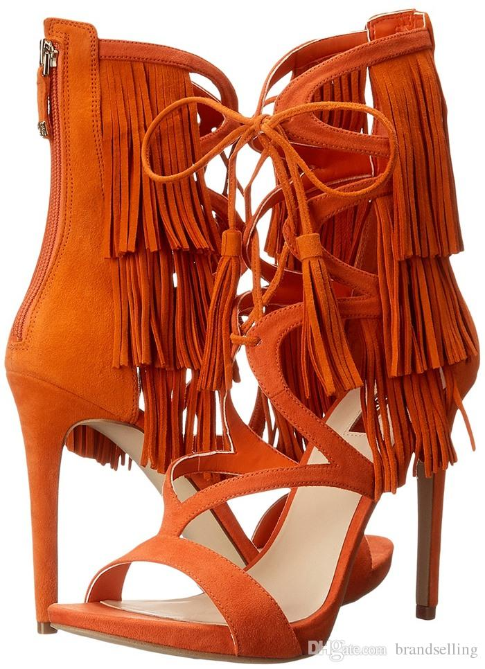 2016 fashionable cage style sandal soft suede covered sandal with bending straps and 4 1/2 inch heel. Full fringe high heel sandal for feme