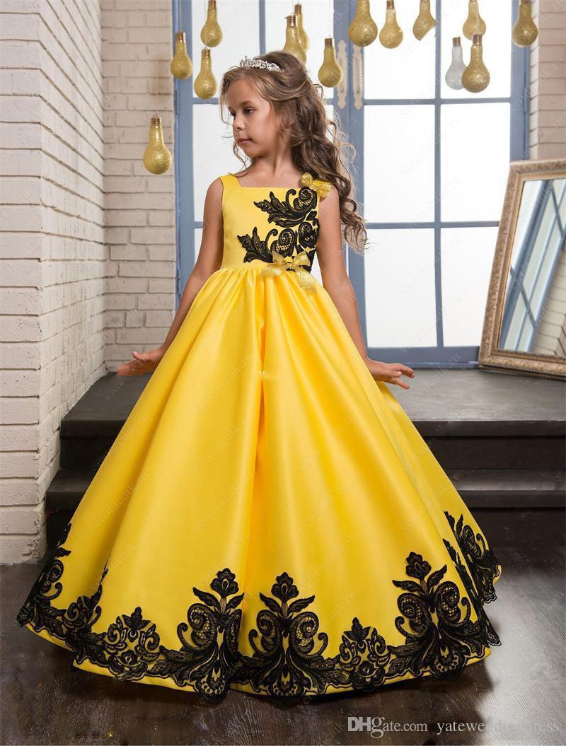 黄色と黒のレースのアップリケの花の女の子のドレスの床の床の長さの習慣カップケーキ子供ドレス