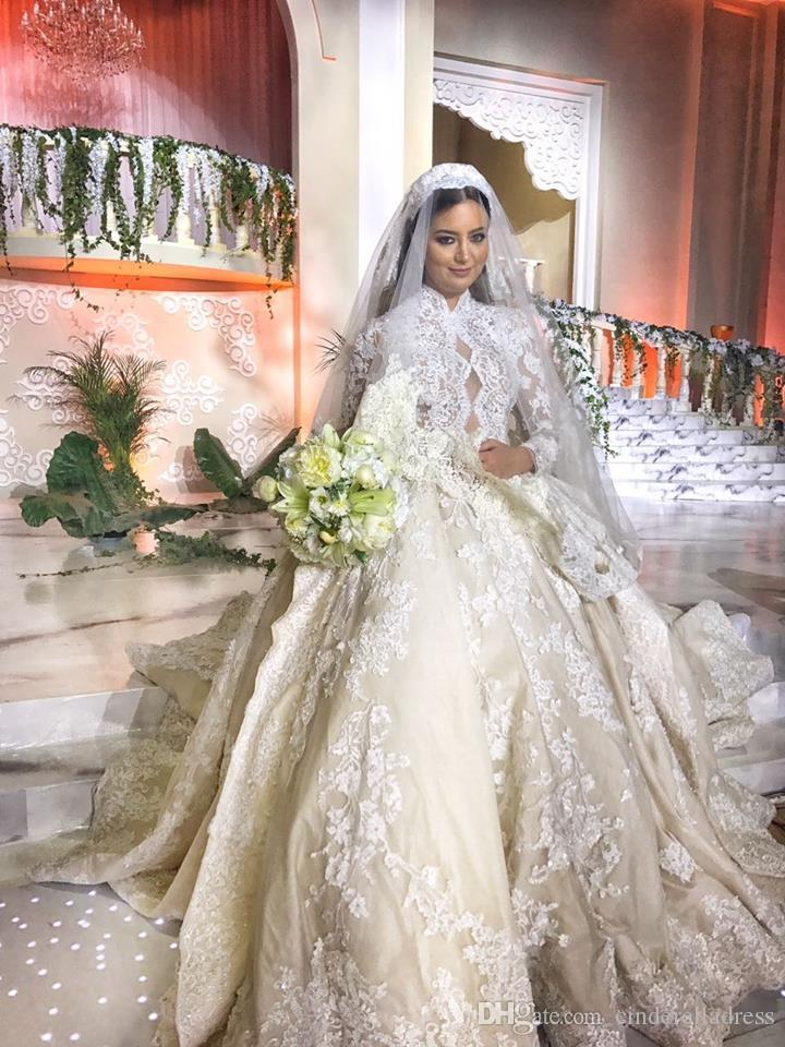 2018 Royal Vintage Ball Gown Long Sleeves Wedding Dresses With Applique Lace Covered Button Bridal Gowns Peplum Ruffles Cathedral Train