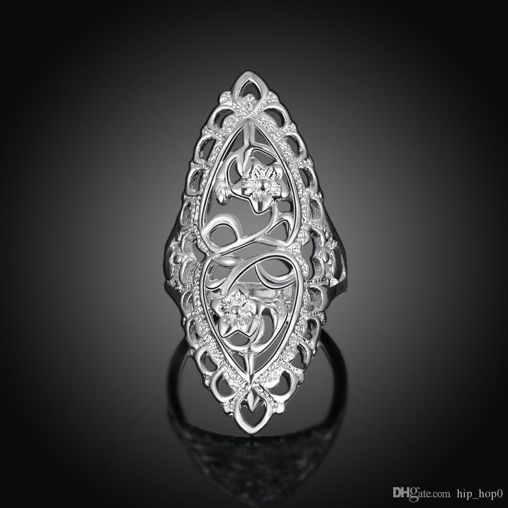 Joyería plateada plata tallada creativa clásica Declaración elegante del anillo del estilo británico Anillo hueco elegante de la flor para las mujeres Unisex Anillo grande largo