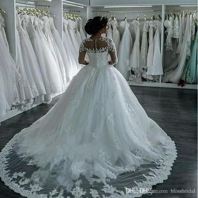 2017 New Dubai Elegant Long Sleeves A-line Wedding Dresses Sheer Crew Neck Lace Appliques Beaded Vestios De Novia Bridal Gowns with Buttons