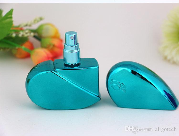 100 jogos / lote Colorido Pequeno 25 ml Amor Forma Portátil Perfume Spray de Garrafas Da Bomba de Alta Qualidade Amostra Cosmética Pulverizador Garrafas Livre DHL navio