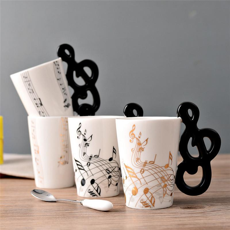 Novedad Guitarra Taza de cerámica Personalidad Música Nota Jugo de leche Taza de limón Café Taza de té Oficina en casa Drinkware Regalo único Envío gratis