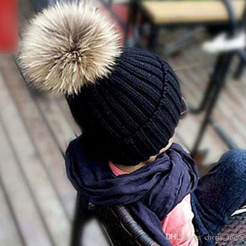 dc976be1807 2019 Stylish Winter Warm Kids Caps With Fur Ball Thick Cotton Knited Childrens  Knitted Hat For Boys And Girls Sweater Cap A7566 From Cherry room