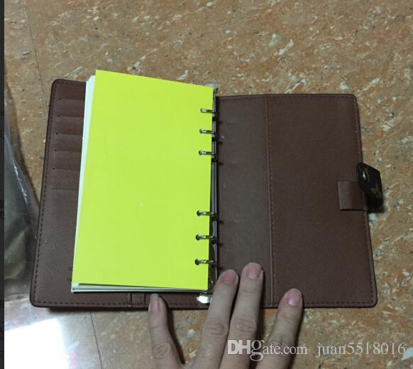Marchio famoso Ordine del giorno di lusso Nota di marca Copertina in pelle Diary in pelle con sacchetto di polvere e scatola di carta Nota libri stile di vendita calda anello d'argento