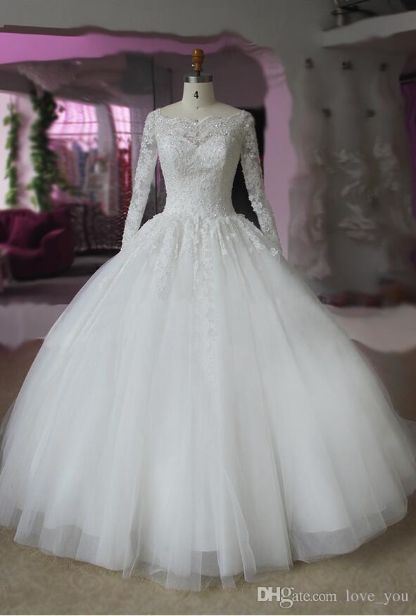 Vestido de novia con flecos de color marfil y apliques de fiesta real Vestido de novia de manga larga