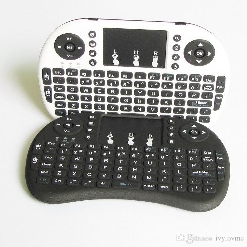 Vente chaude! 2.4G sans fil Qwerty wifi clavier avec pavé tactile Air volant écureuil / souris pour téléphone / pad / PC / Smart TV Livraison gratuite