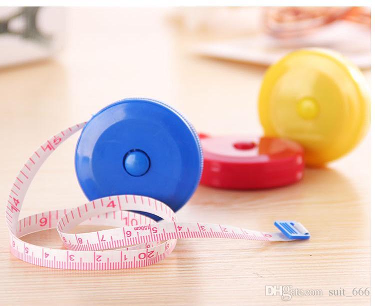 Livraison gratuiteSoft pied ruban à mesurer rétractable en plastique de bonbons de bande dessinée mesures métriques mètre bâton règle ruban à mesurer oeil au beurre noir