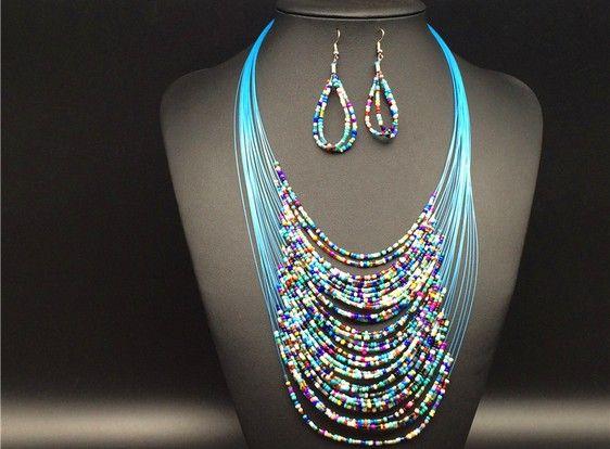 Set di gioielli vintage più recenti di moda Joker Bohemian Multistrato Africa colorata perline Orecchini collana Set KX