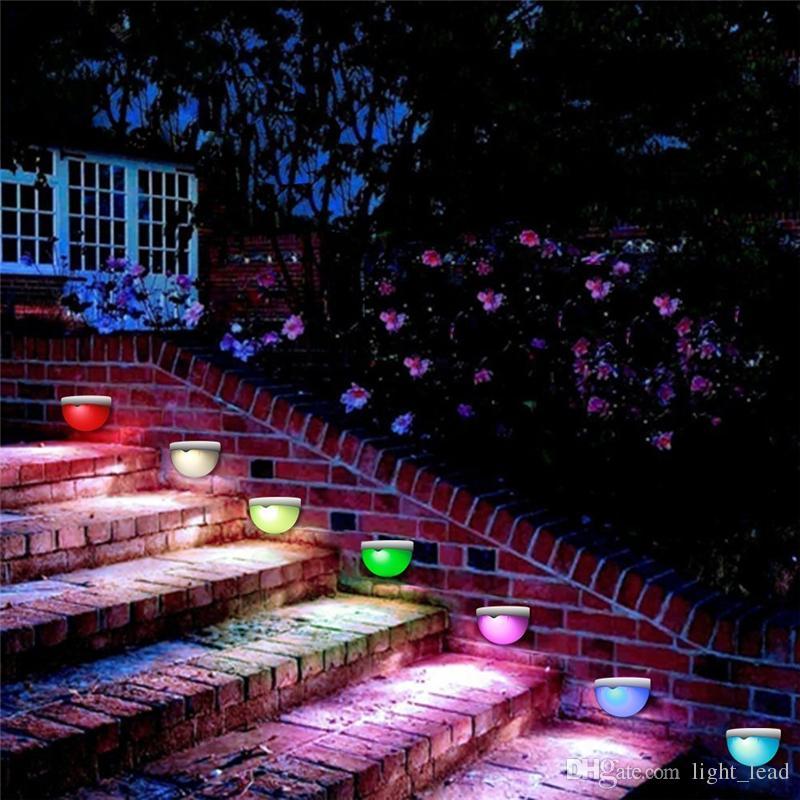 Luces solares LED al aire libre RGB coloridas luces solares montadas en la pared a prueba de agua para el camino del patio camino de la escalera