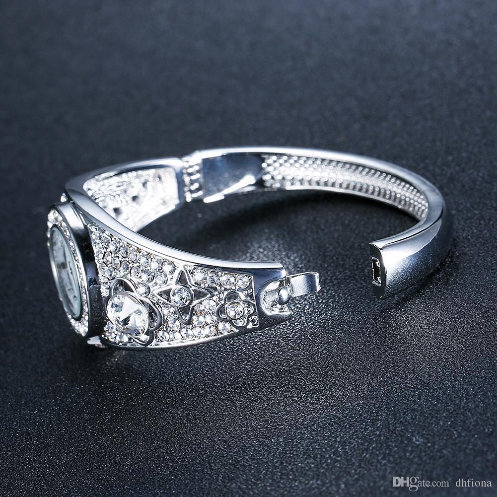 Nouveau Design Diamant Montres Singapour Mouvement De Luxe Montres Moulage Bracelet Bandes Dames Montres Pour Femmes 61166087