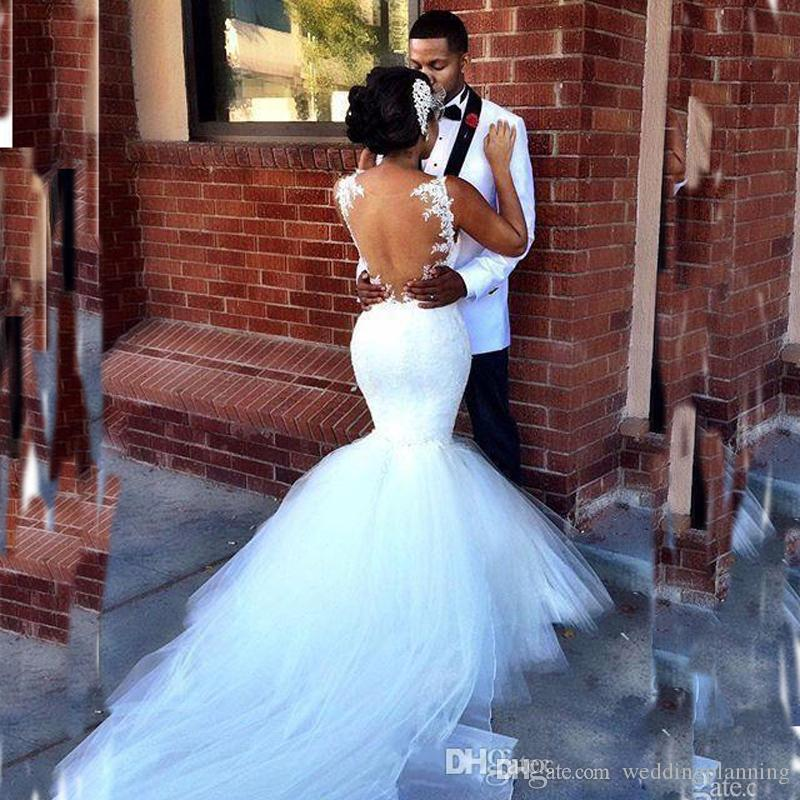 2017 South African Mermaid Wedding Dresses Spaghetti Straps Lace Appliques Ruched Sheer Back Floor Length Plus Size Bridal Gowns Puffy Skirt