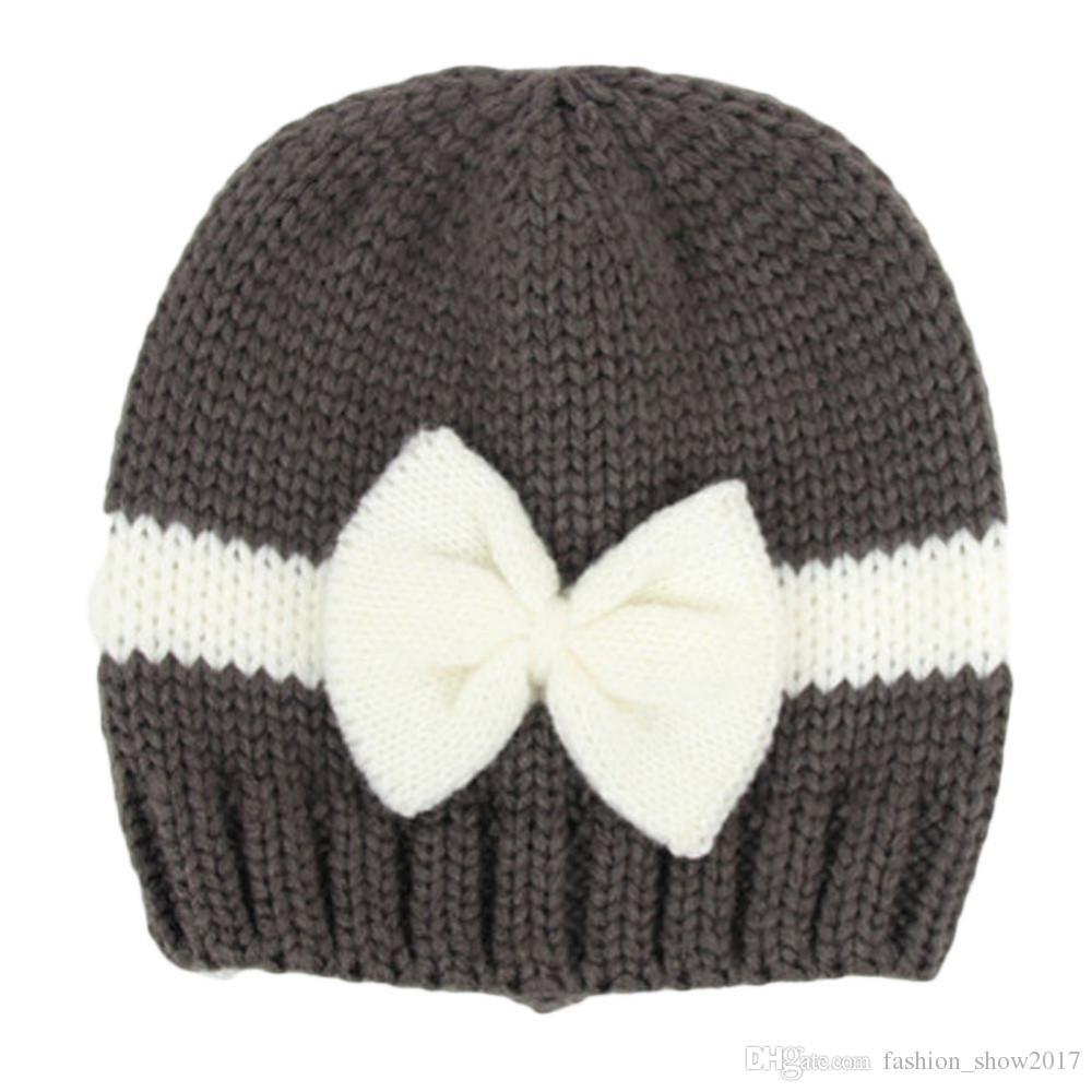 Вязаная шапка для мальчиков Дети девочки Мальчики с бантом узел Вязаная шапка для вязания крючком Новорожденный Зимняя теплая шапка Зимние шапки для девочки