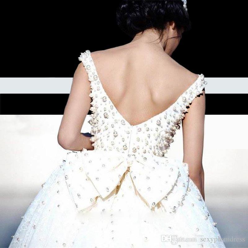 Affascinanti perle perline perline abiti da sposa in pizzo di lusso 2017 scollo scollatura aperta con l'arco a ballo abito abiti da sposa Vestido Noiva su misura