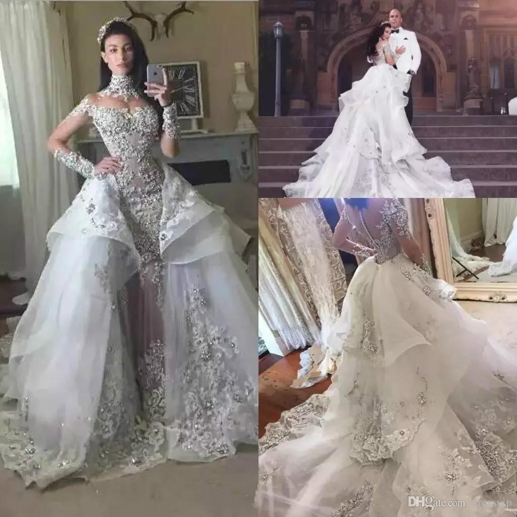 Luxury silver crystal wedding dresses 2018 high neck sheer long luxury silver crystal wedding dresses 2018 high neck sheer long sleeves lace appliques beads bridal gowns with detachable skirts arabic gown taffeta mermaid junglespirit Image collections