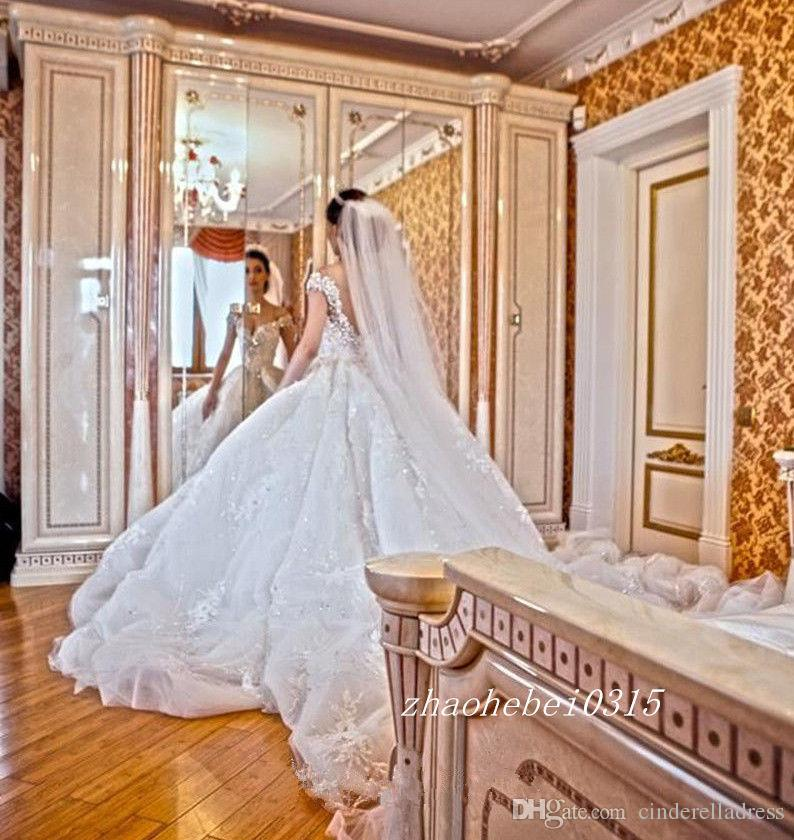Luxurious V neck Crystal Lace Wedding Dresses Cap Sleeves Rhinestones Appliques Cathedral Train Chapel Garden Winter Bridal Gowns Plus Size