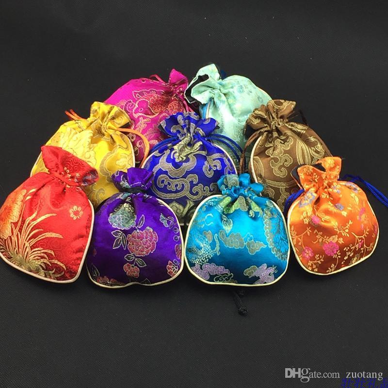 Il cotone ha riempito le piccole borse del cordone del tessuto di seta il commercio all'ingrosso / del sacchetto di immagazzinaggio dei mestieri del regalo dei monili