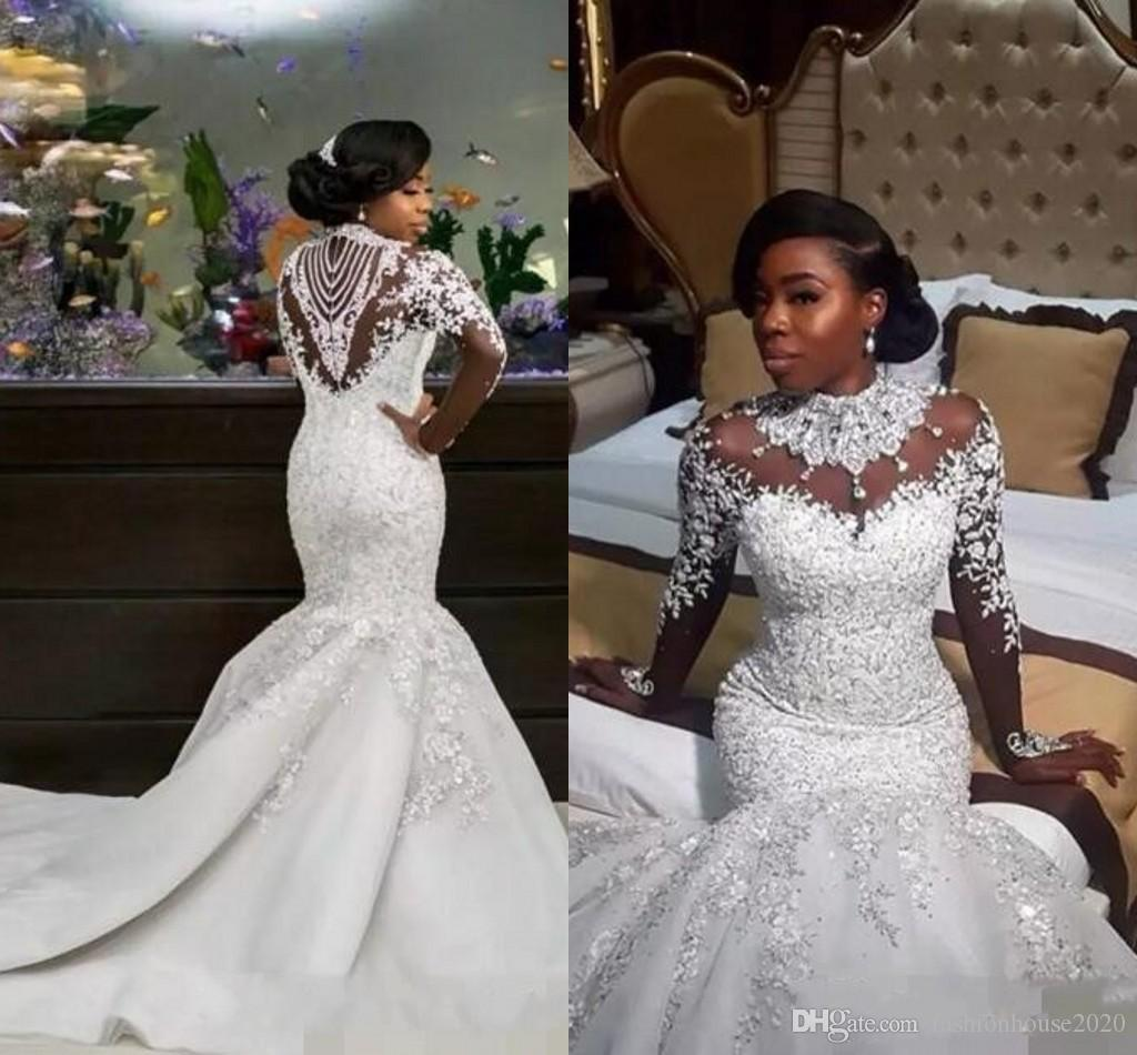 1c5773bfc63 2018 New Luxury African Mermaid Wedding Dresses Long Sleeves High Neck  Illusion Lace Appliques Crystal Beading Sheer Custom Bridal Gowns White  Mermaid ...