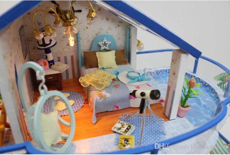 DIY casa de muñecas miniatura de los muebles de madera de la referencia de los juguetes desarrollo intelectual de luz LED Regalo de Navidad Blue Sea la casa los niños
