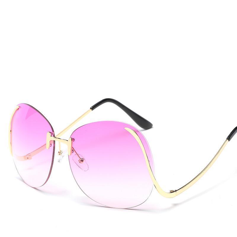 b952337c9603d Compre New Frameless Designer Óculos De Sol Para Homens Mulheres Com Moda  De Alta Definição Oceano Filme De Alta Qualidade Clássico Retro Luxo Óculos  De Sol ...