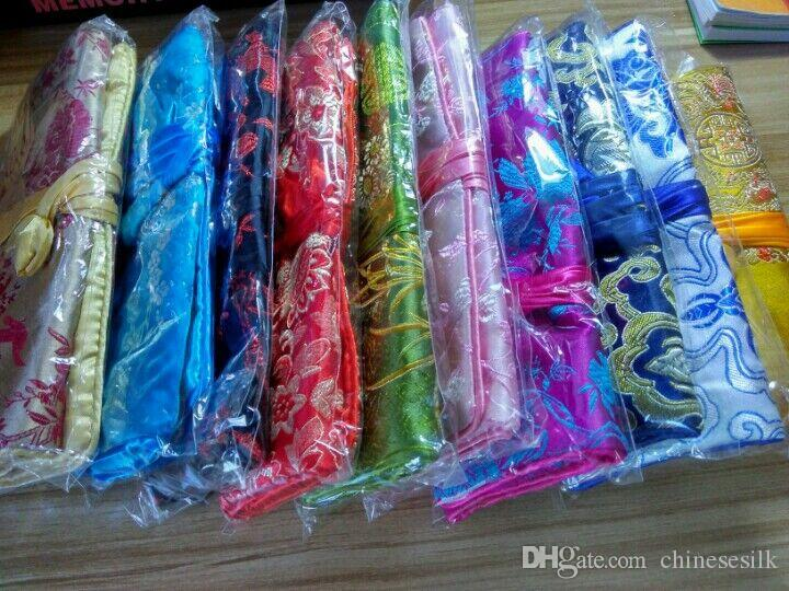 Bolso de almacenamiento de rollos de joyería de viaje de lujo de seda brocado plegable bolsa de maquillaje grande flor lazo bolso cosmético bolsa para mujeres 10 unids / lote
