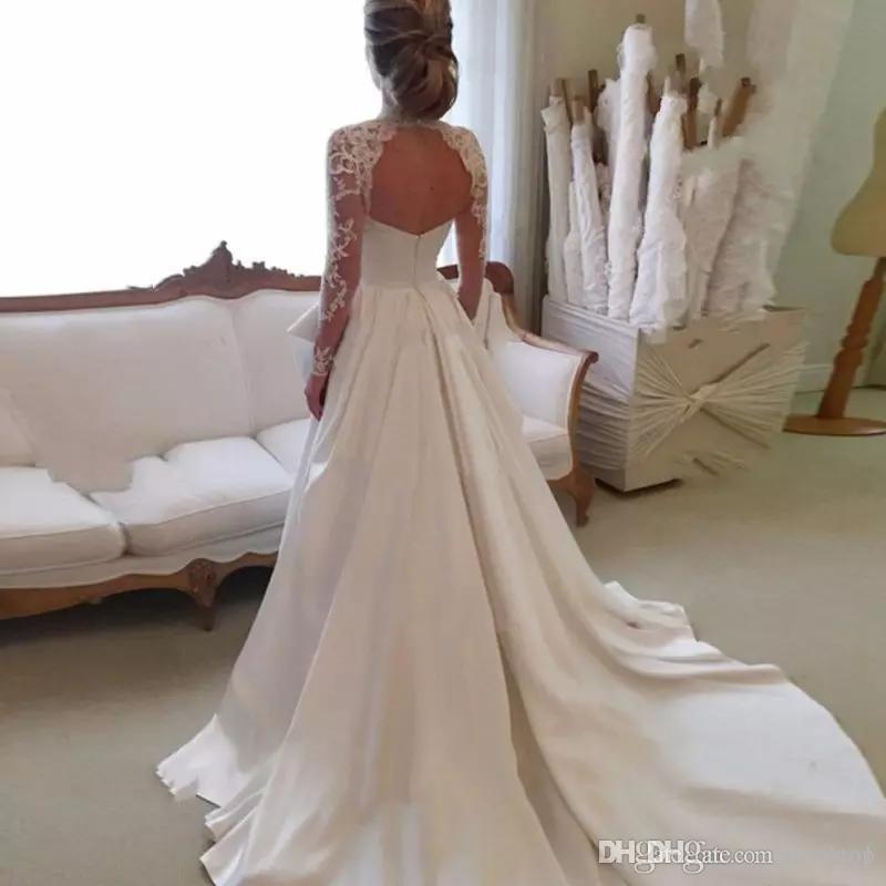 2020 الرباط فساتين الزفاف الوهم أنيقة طويلة الأكمام فساتين الزفاف الرقبة العالية الجوف العودة فستان الزفاف مع طويلة الحرير قطار