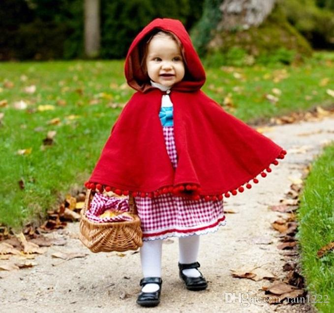 Ins neue Frühlings-Herbst-Winter-Mädchen-rote Weihnachtsponcho-Mäntel Kinder scherzt nette flockige Ball-mit Kapuze Mantel-Baby-Kleinkind-festliche Abnutzungs-Kleidung