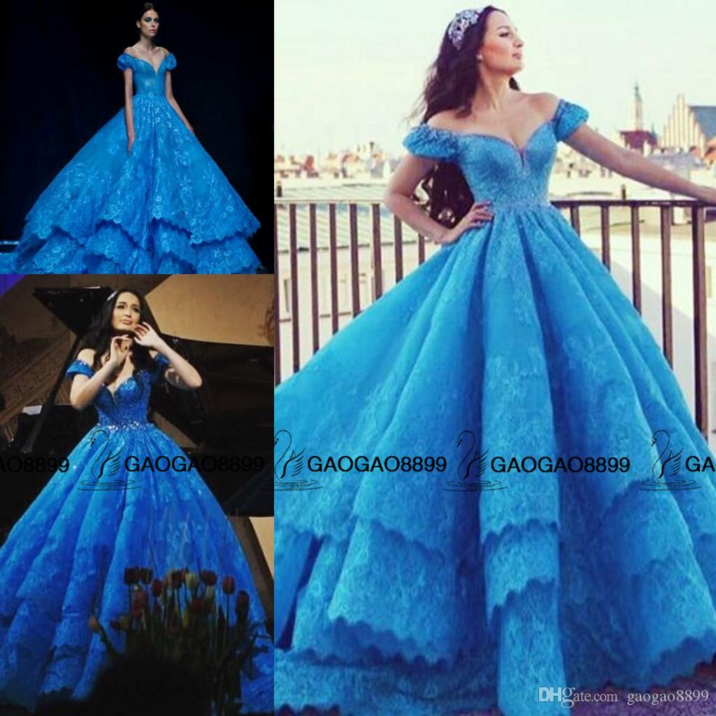 cinderella in michael cinco blue lace gown prom dresses