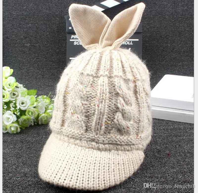 النسخة الكورية من شعبية الخريف والشتاء قبعة جديدة آذان أرنب النساء محبوك سترة من الصوف الدافئة بالإضافة إلى الأزياء الكشمير قبعة الجملة