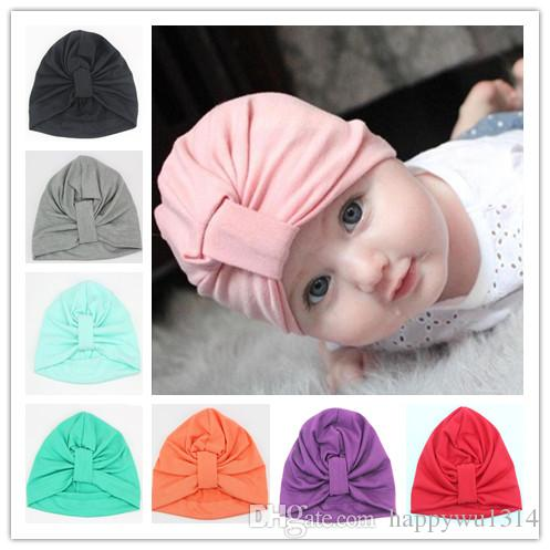 2019 Fashion Infant Cotton Beanie Hats Baby Girls Bohemia Twisted Knot Soft  Hedging Caps Autumn Winter Warm Cotton Cap Hair Accessories From  Happywu1314 6bcecdaba3d