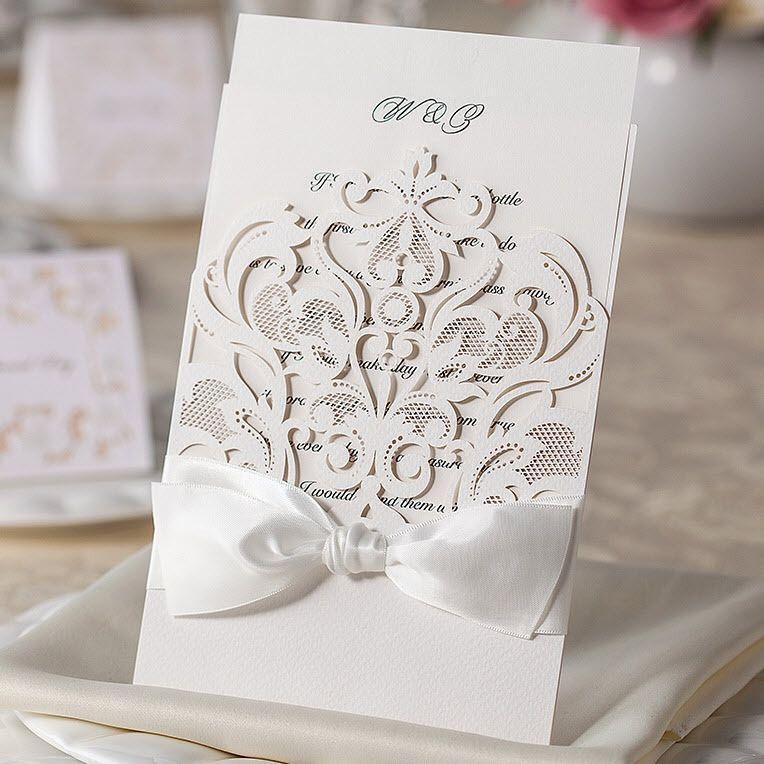 Elegant white laser patterns with white silk tie wedding invitations elegant white laser patterns with white silk tie wedding invitations cards by wishmade wm200 cheap wedding invitations canada cheap wedding shower filmwisefo