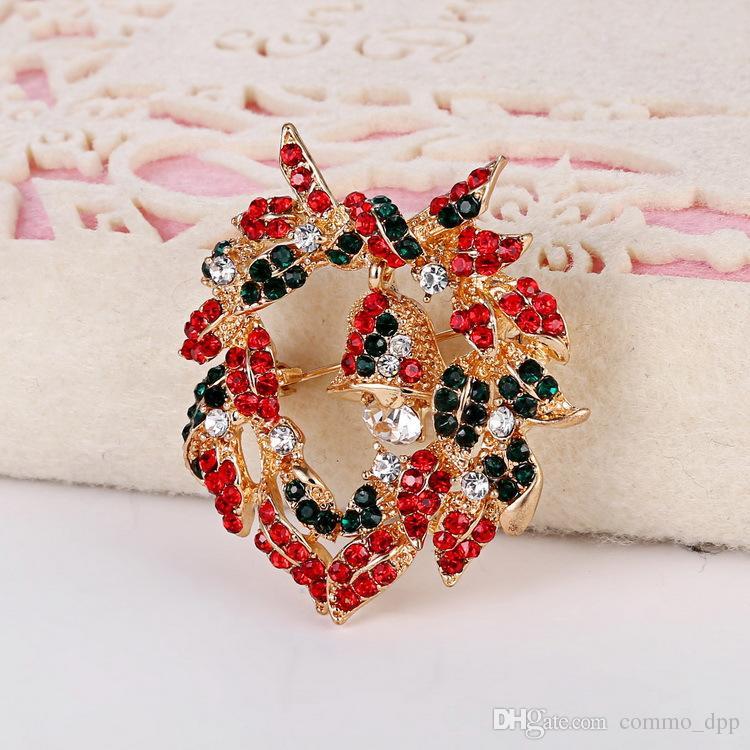 Moda joyería de Navidad mujeres broches de lujo Crystal Rhinestone pequeño Bell Garland broches Pin para el regalo de Navidad al por mayor en China