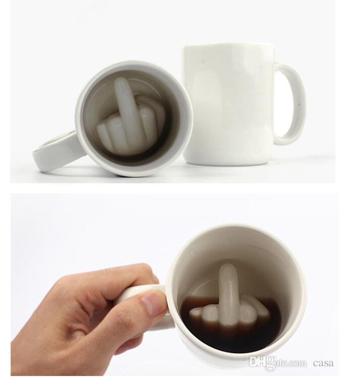 Diseño creativo taza de cerámica del dedo medio estilo de la novedad que mezcla café taza de leche taza de cerámica divertida taza de agua 100 unids