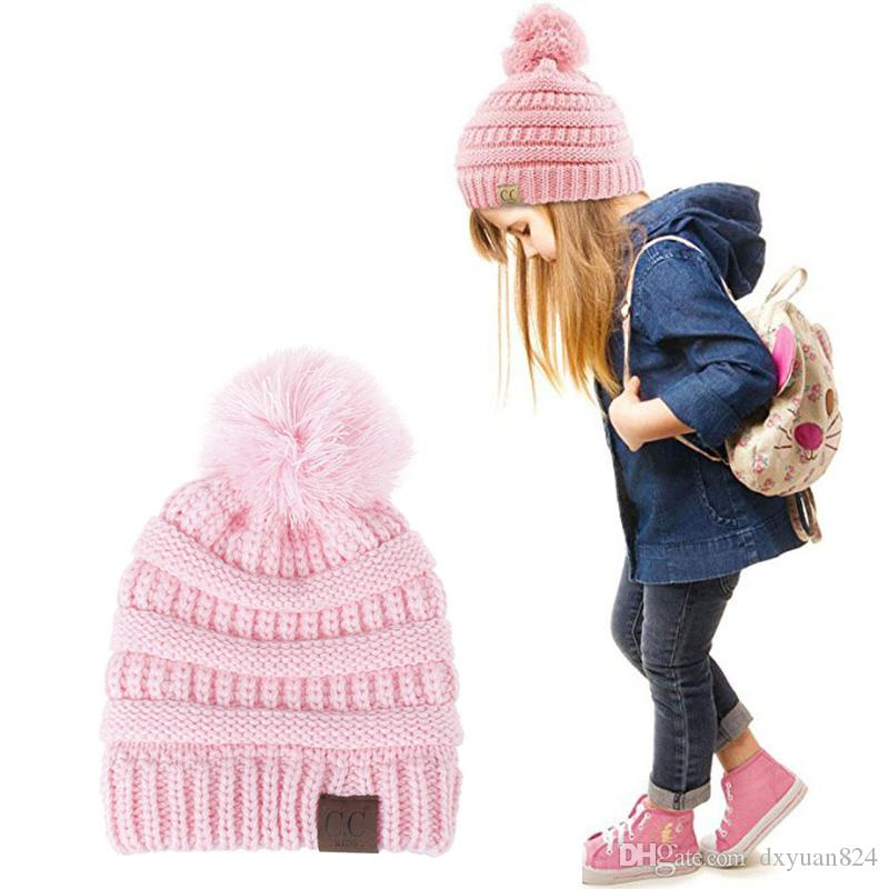 Fashion CC Beanie Kids Knitted Hats Cute Fur Ball Pompom Winter Baby Caps  Thick Cotton Childrens Warm Trendy Soft Hat For Boys Girls Knit Hat Hats  And Caps ... 00f4ebc84c6d