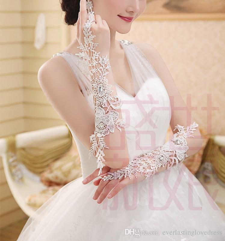 Wunderschöne Luxus Elfenbein Ellenbogen Länge Fingerlose Spitze Applizierte Brauthandschuhe Lange Hochzeit Handschuhe Mit Kristallen