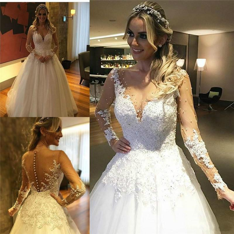 3dcec73de13a Discount Modern Long Sleeves Lace Wedding Dresses With Pearls 2016 Beads  Tulle Sheer Jewel Neckline A Line Train Bridal Gowns Wedding Ball Aline  Wedding ...
