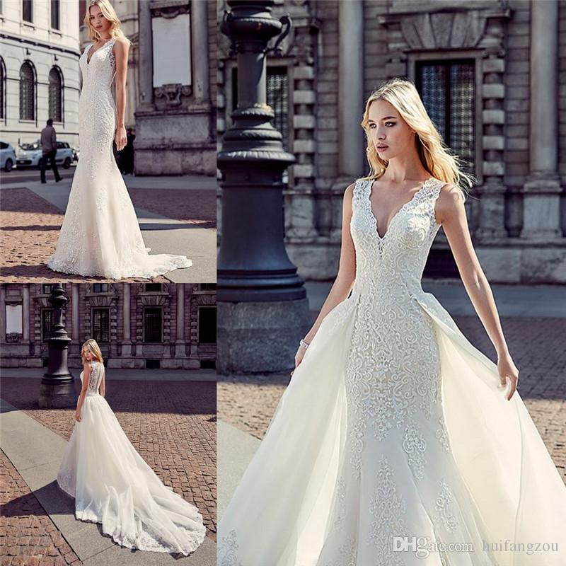 21 Gorgeous Wedding Dresses From 100 To 1 000: Gorgeous Mermaid Overskirt Wedding Dresses Plunging