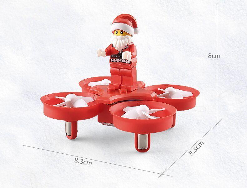 Aerei di telecomando del giocattolo di Natale dell'elicottero di Santa Claus Quadcopter della mosca con la musica di Natale della luce del LED il regalo dei bambini