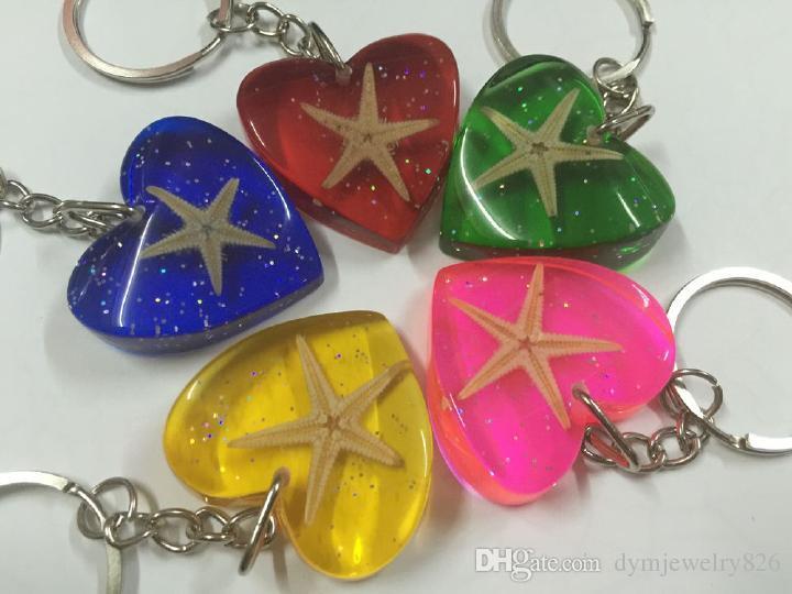 Livraison gratuite étoile de mer véritable insecte bijoux cool mélangé coloré porte-clés