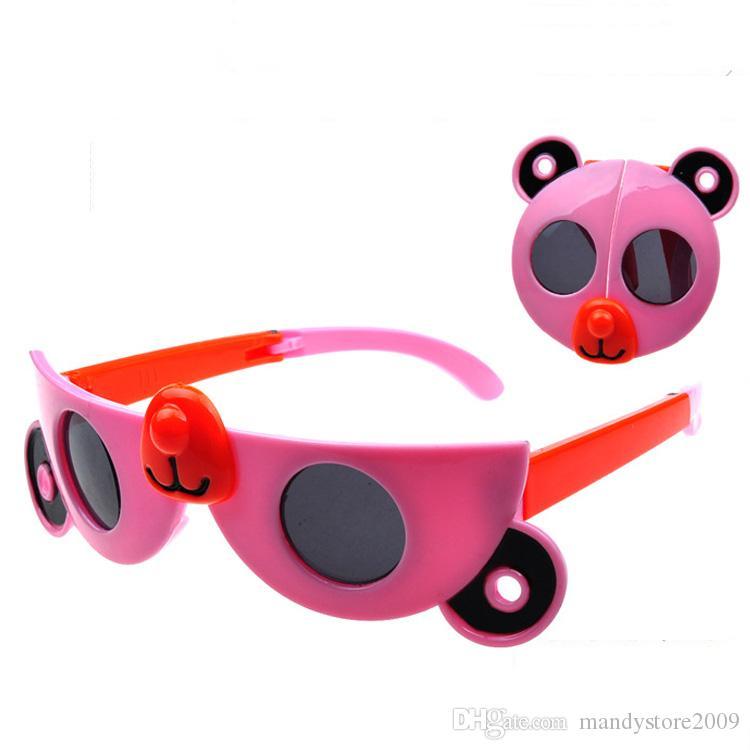 Gafas de sol del bebé de la historieta linda Gafas de sol plegables de la pierna de la forma de la Osa gafas de sol para niños playa de los niños Bloqueador solar Accesorios Blinkers